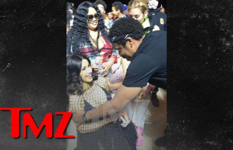Jay-Z Rubs Cardi B's Baby Bump During Beyonce's Coachella Set | TMZ 1